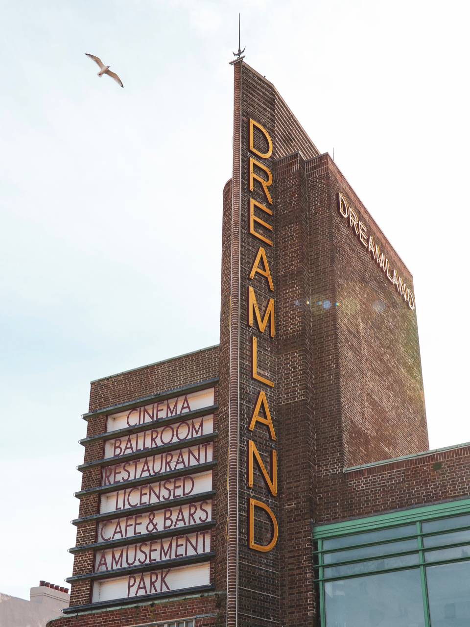 The Dreamland Building has a sign to show its services: Cinema, Ballroom, Restaurant, Cafe and Bars, Amusement Park - One Day in Margate
