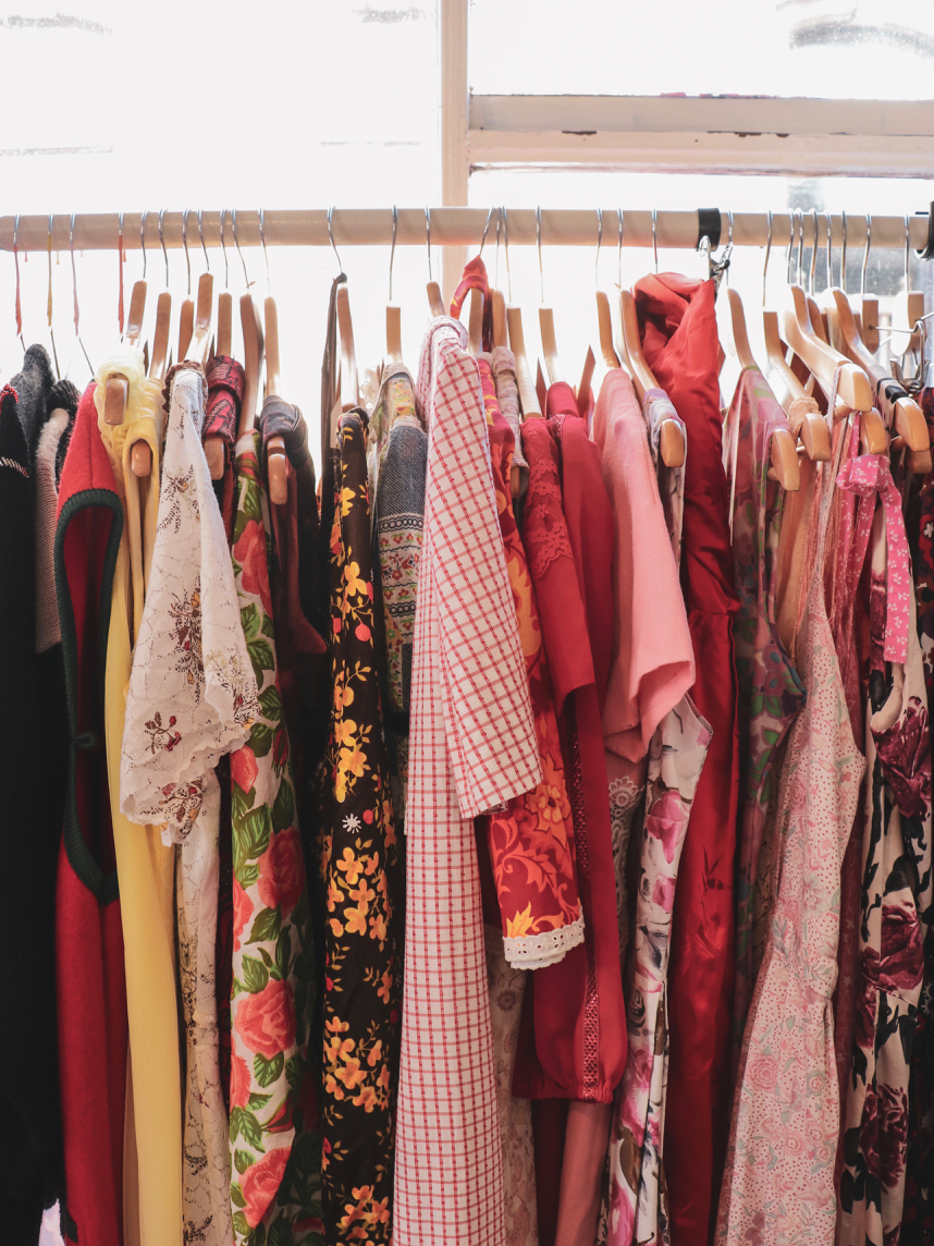Rows of brightly coloured women's vintage garments on a clothing rack in a vintage clothing store in Margate - One Day in Margate